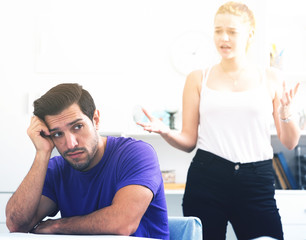 Frustrated guy at table with dissatisfied girlfriend