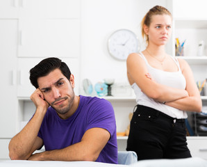 Man at home table after quarrel with wife