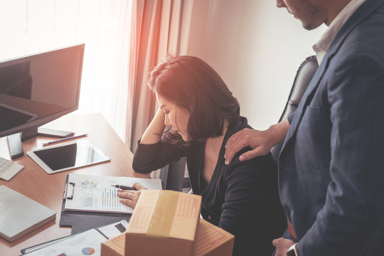 Male boss is consolidating stressed out business woman