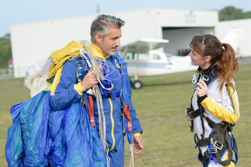 skydivers ready to jump
