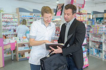 happy pharmacist and man customer