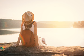 Asian girl backpack in nature during sunset , Relax time on holiday concept travel,selective and soft focus,color tone of hipster style Fotomurais