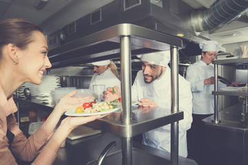 Chef with team preparing food