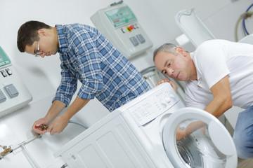 professional handyman repairing washing machine