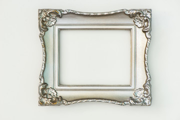Silver painted frame with gold peeking through on white