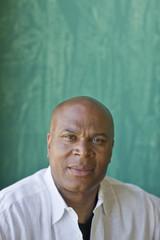 Portrait of a bald mid-adult man.