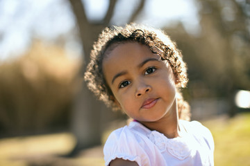 Portrait of young girl outside.