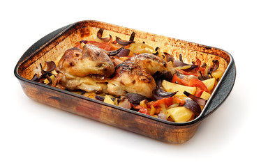 Baked chicken with vegetables in glass baking tray