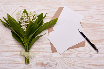 Blank sheets with envelope and flowers.