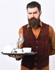 Barman with proud face serves coffee or alcohol drink.