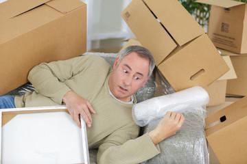 man in cardboard box