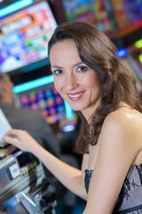 portrait of woman at machine in casino