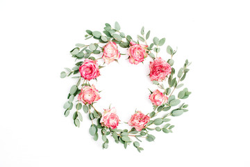 Floral frame wreath made of red rose flowers and eucalyptus branches on white background. Flat lay, top view festive mockup with copy space.