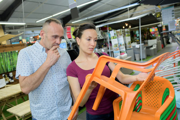 couple buying plastic chairs