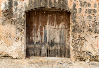 Old wooden door of an old house.