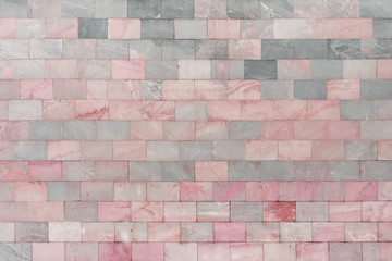 Wall of marble pink tiles. Beautiful stone texture. Empty background