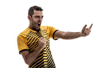 Soccer fan with yellow shirt celebrating on white background