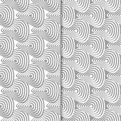 Gray and white geometric ornaments. Set of seamless patterns