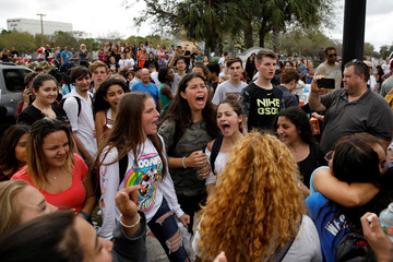 Students shout slogans during a protest to show support for Marjory Stoneman Douglas High School, following a mass shooting in Parkland
