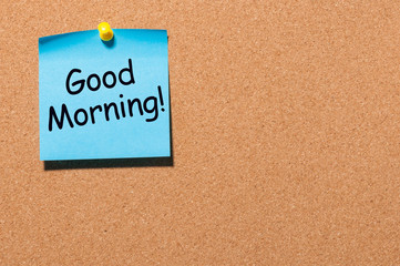 Good morning wishes in note pinned at office corkboard with empty space for text, mockup or template
