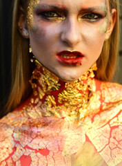 Halloween vampire zombie woman with cracked skin