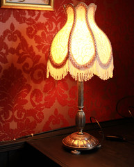 Vintage old fabric lamp with fringe