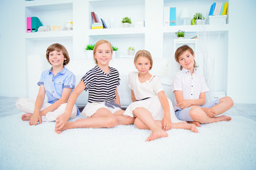 children are sitting on floor