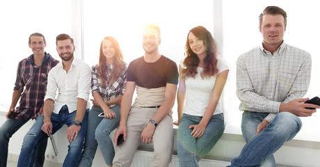 creative team sitting on the windowsill