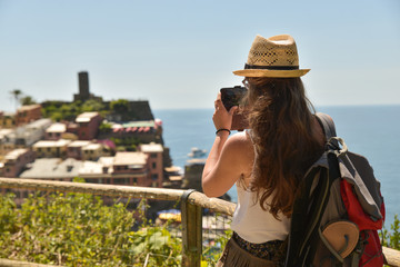 Cinque Terre, Italy - 15th August 2017:Girl taking photos with her mobile
