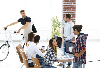 group of young employees in a modern office