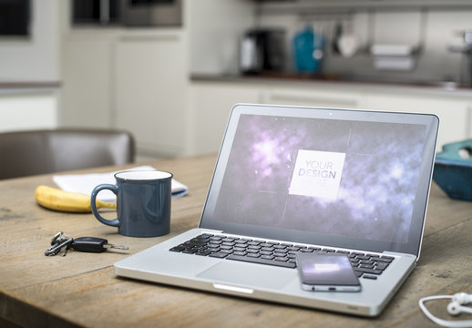 Laptop and Smartphone on Kitchen Table Mockup 1