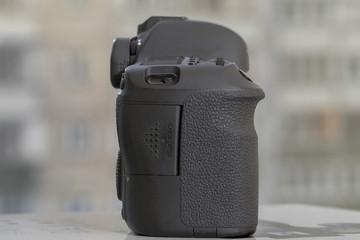 Digital DSLR camera on blured background
