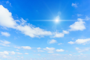 Sun with blue sky background.