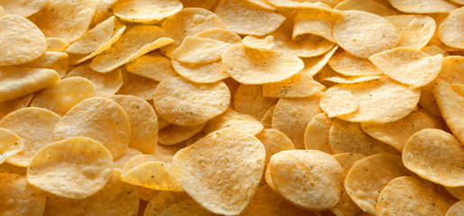 Potato chips panorama, texture, background.