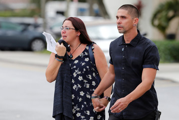 Mourners leave a service for Carmen Marie Schentrup, one of the victims of the school shooting, at St. Andrew Catholic Church in Coral Springs