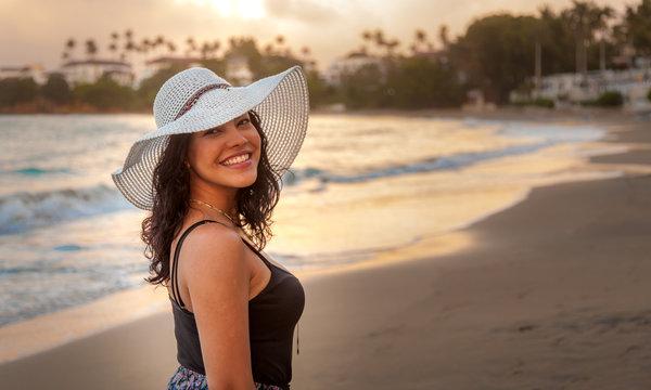 Latina woman on holiday at the beach 4
