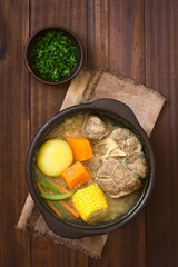 Traditional Chilean Cazuela de Vacuno or Cazuela de Carne beef soup with potato, corn, pumpkin, carrot, bell pepper, onion, rice, photographed overhead with natural light (Selective Focus on the soup)
