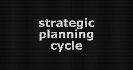 Strategic planning cycle word on grey background.