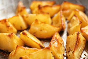 Delicious oven baked potatoes, closeup