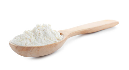 Spoon with flour on white background