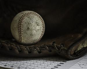 Baseball With Baseball Glove and Scorebook