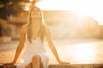 Carefree woman enjoying in nature,beautiful red sunset sunshine.Finding inner peace.Spiritual healing lifestyle.Enjoying peace,anti-stress therapy,mindfulness meditation.Positive energy.Freedom