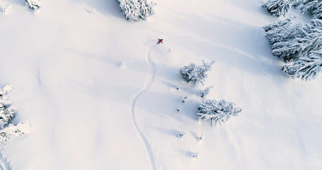 Foto auf Acrylglas Wintersport Snowboarder Drone Angle Powder Turns Fresh Untracked Mountain Powder Snow Aerial View