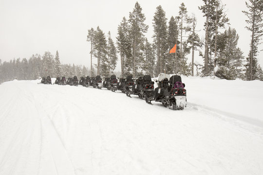 Snowmobiles parked on road in Yellowstone National Park in winter