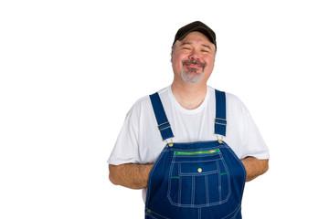 Smiling man wearing dungarees on white background