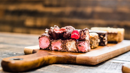 Assorted cake slices on a wooden table