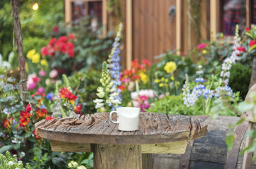 Coffee cup and table in Backyard garden of residential house