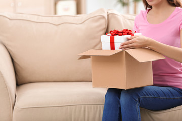 Woman received gift in parcel box at home
