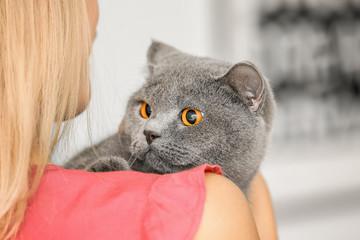 Young woman with cute pet cat, closeup