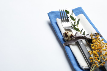 Beautifully decorated cutlery for Easter table setting on white background